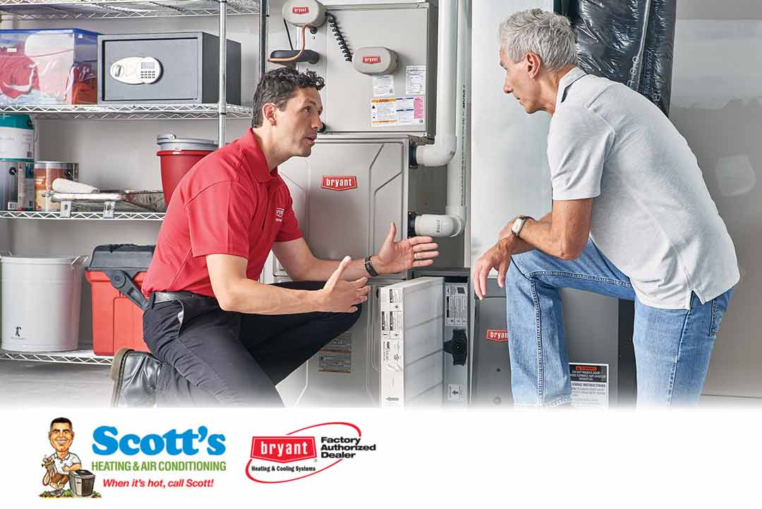 Bryant™ air conditioner maintenance technician in a customer's home explaining how to prepare the air conditioner for winter.