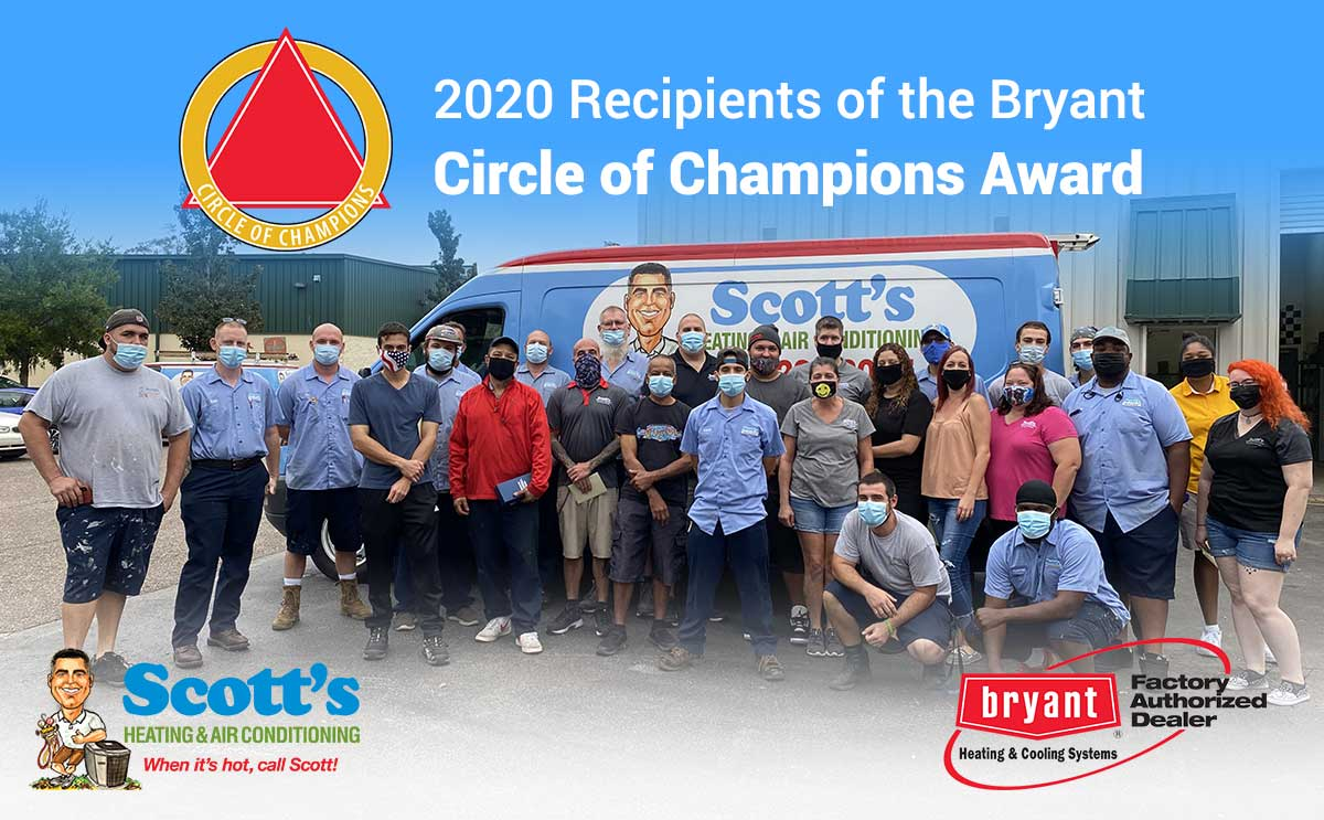 The Scotts Air team in from of one of their vans with the copy 2020 Recipients of the Bryant Heating and Coolings 2020 Circle of Champions award